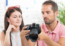 A young couple looking at pictures Stock Photos