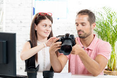 A young couple looking at pictures Royalty Free Stock Photography