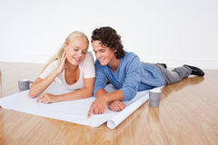 Young couple looking at a plan Royalty Free Stock Image