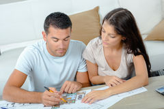Young couple looking for plans new house Stock Photography