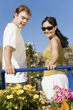 Young couple looking at potted flowers Stock Images