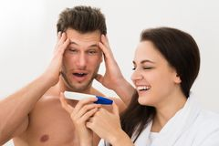 Young couple looking at pregnancy test royalty free stock photo