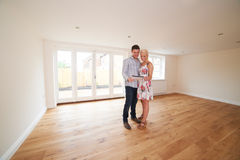 Young Couple Looking At Property Details For New Home Stock Image