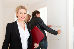 Young couple looking for real estate with realtor Royalty Free Stock Image