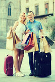 Young couple looking satisfied after shopping stock images