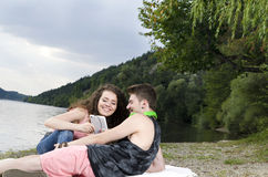 Young couple looking at the screen of mobile device Stock Photos