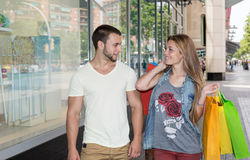 Young couple looking at a shop window Stock Photos