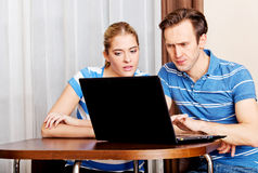 Young couple looking for something on laptop Royalty Free Stock Photo