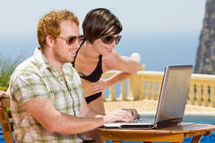 Young Couple Looking at their Laptop Stock Images