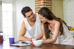 young couple looking their personal organizer in morning Stock Image