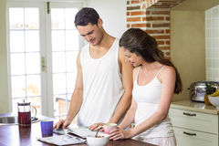 young couple looking their personal organizer in morning Royalty Free Stock Photo