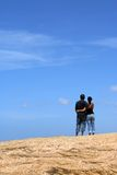 Young couple looking up together. With sky background stock photos