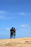 Young couple looking up together. With sky background royalty free stock photo