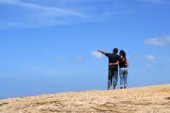 Young couple looking up together. With sky background stock images