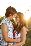 Young couple lost in love. Outdoor during the sunset Royalty Free Stock Images