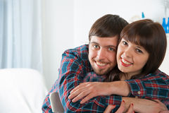 Young couple lounging in couch Stock Photo