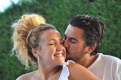 Young Couple in Love. An adorable couple is enjoying their love Stock Image