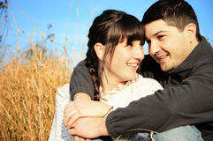 Young couple in love. A portrait of a young couple in love, lying outdoors Stock Image