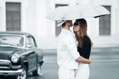 Happy young fashion couple in love with umbrella Stock Photography