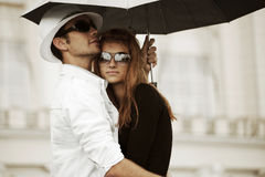 Young fashion couple in love with umbrella Royalty Free Stock Photo