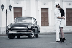 Young fashion couple in love at the retro car Stock Photography