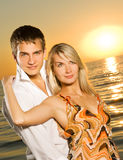 Young couple in love. Near the ocean at sunset Stock Photo