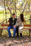 Young couple in love. Sitting on bench in the park Royalty Free Stock Photos