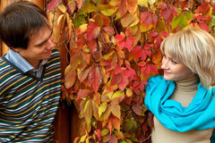 Young couple in love in autumn forest. Stock Photos