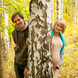 Young couple in love in autumn forest. Stock Photography
