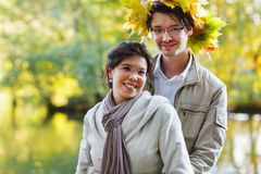 Young couple in love with autumn maple leaves in park at fall outdoors date. stock photos