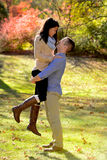 Young couple in love in an autumn setting Stock Photos