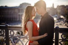 Young couple in love on the background of beautiful city Royalty Free Stock Photography