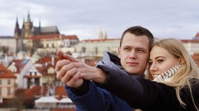 Young couple in love on the background of Prague Castle stock images