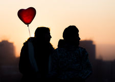Young couple in love balloon heart Stock Images