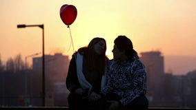 Young couple in love balloon heart valentine's day stock footage