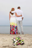 Young couple in love at the beach Stock Images