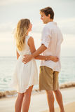 Young couple in love on the beach sunset Royalty Free Stock Photo