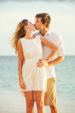 Young couple in love on the beach sunset Royalty Free Stock Photography