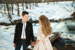 Young couple in love. Beautiful couple in love honeymoon in the spring outdoors on a background of autumn nature and a river at sunset Royalty Free Stock Images