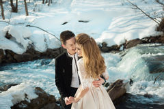 Young couple in love. Beautiful couple in love honeymoon in the spring outdoors on a background of autumn nature and a river at sunset Royalty Free Stock Photos