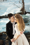 Young couple in love. Beautiful couple in love honeymoon in the spring outdoors on a background of autumn nature and a river at sunset Stock Photos