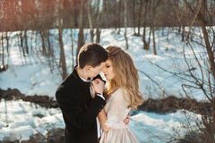 Young couple in love. Beautiful couple in love honeymoon in the spring outdoors on a background of autumn nature and a river at sunset Stock Photography