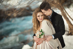 Young couple in love. Beautiful young couple in love outdoors in spring Royalty Free Stock Images