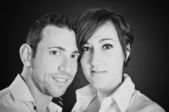 Young couple in love on black background Stock Image