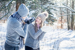 Young couple in love blows snow Stock Images