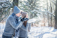 Young couple in love blows snow Stock Photo