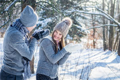 Young couple in love blows snow Royalty Free Stock Photo
