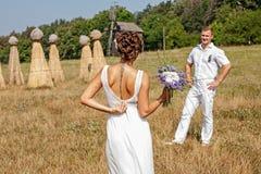 Young couple in love bride and groom at field Imagen de archivo libre de regalías