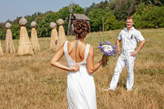 Young couple in love bride and groom at field. Young couple in love bride and groom posing in a field Royalty Free Stock Image