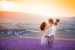 Young couple in love bride and groom, wedding day in summer. Enjoy a moment of happiness and love in a lavender field